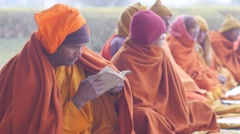 Monk studying in sacred garden,Lumbini,Nepal Stock Footage