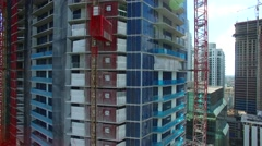 AERIAL - Building in construction elevator Stock Footage