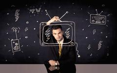 Happy businessman drawing tv and radio Stock Photos