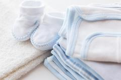 close up of baby boys clothes for newborn on table - stock photo