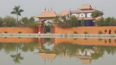 Linh Son Monastary with reflection in pond,Lumbini,Nepal Stock Footage