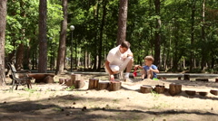 Dad and son play in the sandbox Stock Footage