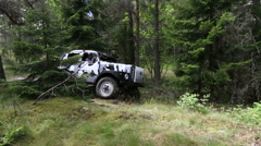 Off road with a 4 wheel drive camouflage colored jeep in a Swedish forest Stock Footage