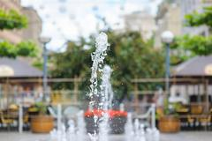 Splashes of water in city fountain Stock Photos