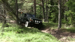 Off road with a 4 wheel drive green jeep in a Swedish forest Stock Footage