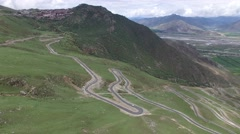 EPIC TIBET LANDSCAPE OF BEAUTIFUL MOUNTAINS WINDY ROAD AND VALLEY BELOW Stock Footage