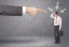Amateur businessman under pressure Stock Photos