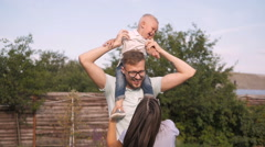 Happy Young Family Having Fun Outdoors. Mom, Dad and Kid Walking, Enjoying Stock Footage