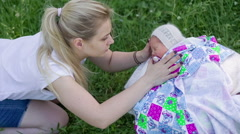 My mother cradles a newborn baby to sleep - stock footage