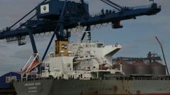 A crane unloads a ship in a Swedish port Stock Footage