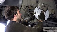 Man repair automobile brake system Stock Footage