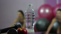 Young woman doing fitness exercises, keeping water balance, eating healthy food Stock Footage