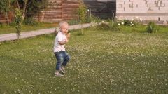 Adorable Kid Boy Dancing On a Summer Meadow Outdoors. Child walking On a Sunny - stock footage