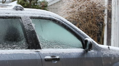 Blue car covered in layer of ice after ice storm. Toronto, Canada. - stock footage