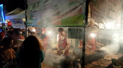 Crowds of people and lots of food at summer Asian night market Stock Footage