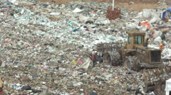 Trucks and Dozers Working in a Garbage Dump ( recycling ) - stock footage