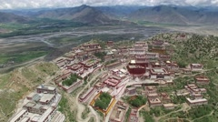 EPIC SEQUENCE - REVERSE REVEAL + POINT OF INTEREST AERIAL OF TIBET MONESTARY Stock Footage