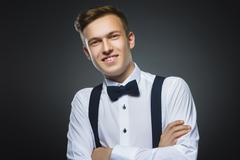 Happy boy. Closeup Portrait of handsome teenager smiling isolated on grey Stock Photos