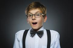 Closeup Portrait of happy boy going surprise isolated on gray background Stock Photos