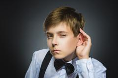 Curious Disappointed boy listens. child hearing something, parents talk, hand to Stock Photos
