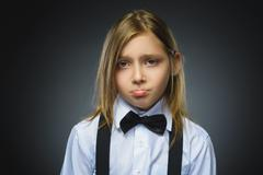 Portrait of offense girl isolated on gray background. Negative human emotion Stock Photos
