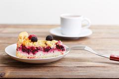 Piece of raspberry tart pie with curd cream and shtreyzel Stock Photos