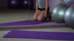 Strong fit woman doing plank exercise, suffering acute pain in injured knee Stock Footage