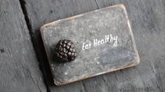 Eat heathy text. Fruit diet, dieting, nutrition, vegetarian concept. Food for - stock footage