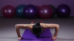 Strong woman doing push-ups, training hard in gym to have healthy fit body Stock Footage