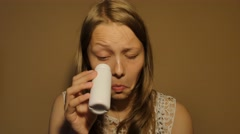 Teen girl drinking milk or yoghurt from a small bottle. 4K UHD Stock Footage