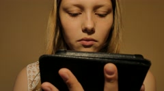 Girl reads e-book e-reader. 4K UHD Stock Footage