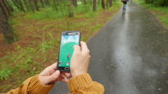 Pokemon Go. We went to the park to play. Stock Footage