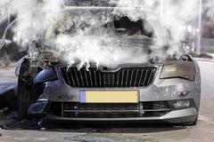 broken steaming car - stock photo