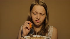 Teen girl eating corn flakes for a breakfast. 4K UHD Stock Footage
