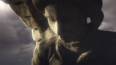 Angel statue in front of stormy sky, animation - stock footage