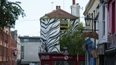 Zebra-painted house in Brighton Stock Footage