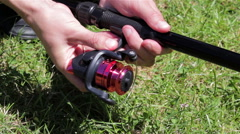 Fishing Reel fasten the Fishing rod Stock Footage