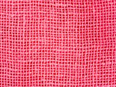 Natural pink fabric weaving as background texture - stock photo