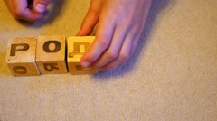 The child puts the words out of blocks Stock Footage