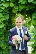 Confident groom in an expensive suit Stock Photos