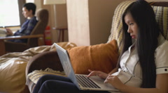 Girl working with computer indoors Stock Footage