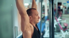 Athlete doing pull-up on horizontal bar in the gym Stock Footage