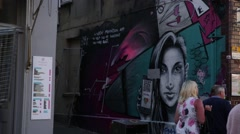 Graffiti of a sexy woman - stock footage