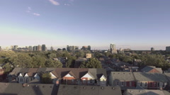 Arial establishing shot of a neighborhood in a large city Stock Footage