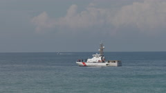 US Coast Guard Cutter at anchor Stock Footage