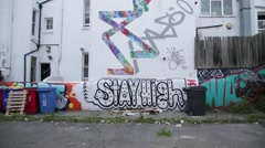 Graffiti-covered home in Brighton - wide angle Stock Footage