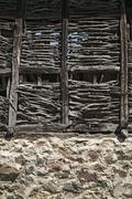 Wall of old weathered farm barn - stock photo