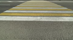 Flight of the Camera Over a Yellow Zebra at the Crosswalk - stock footage