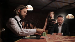 Businessman with a prostitute playing casino blackjack Stock Footage