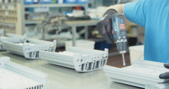 Close up of a worker assembling a LED fixure  Stock Footage